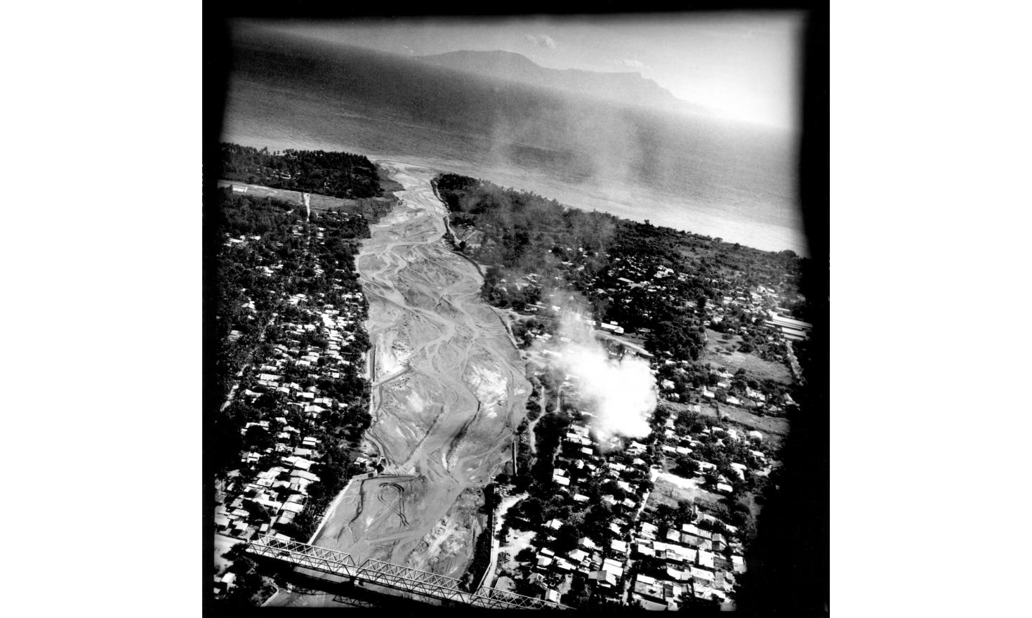"View from Black Hawck: a house burning in Dili, capital of East Timor, where violence between ""Easteners"" and ""Westerners"" erupted in April 2006, June 2006"