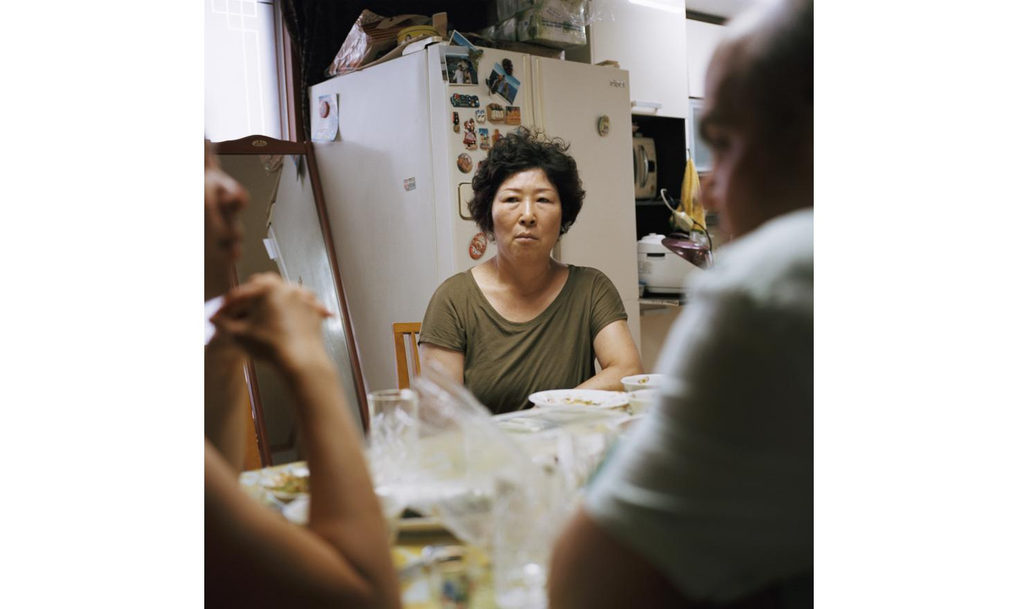 """My husband who have passed away, would have been ashamed when my daughter found me"""".Seoul, 4th of July 2013Mrs. Yang, Hay Suk 59 years old, with her daughter Laure and her boy friend Romain, who came from Switzerland to visit her. Laure calls her biolog"""