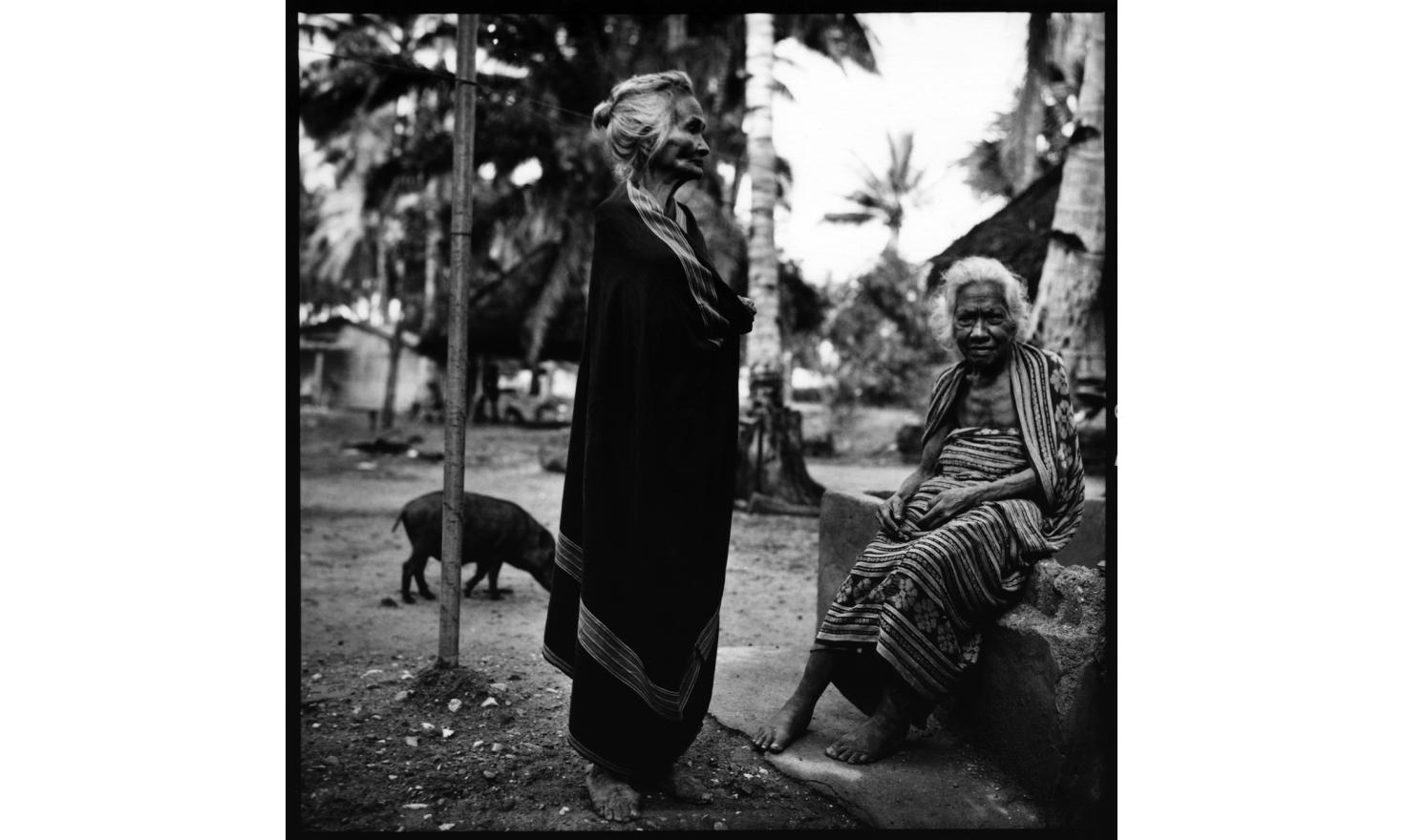 "Old women of Alienbata village. Under Indonesian occupation the village was full since people were ""kept"" in areas the occupants could control. Since the independance, ""economically, life is not as good and easy"