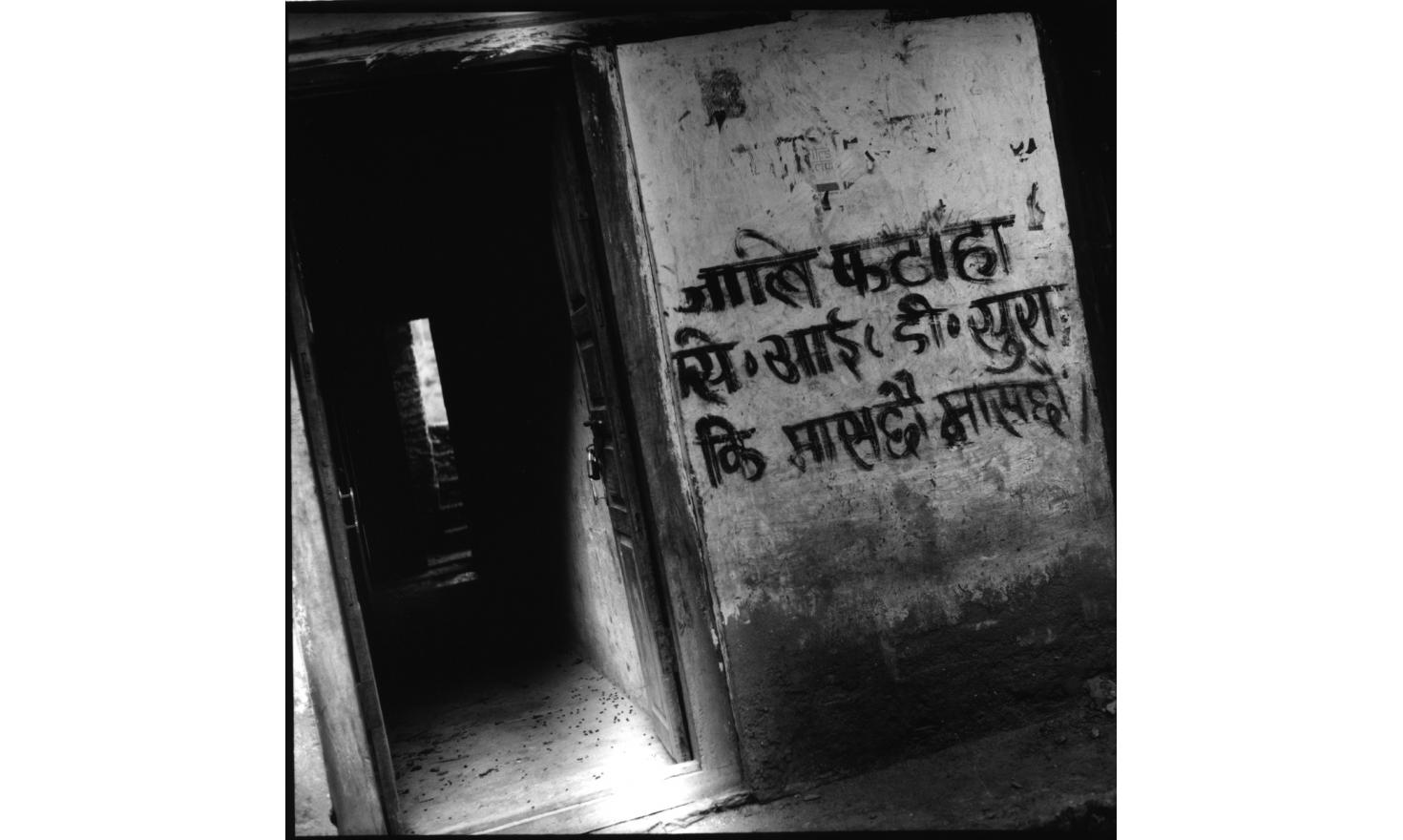 """The walls of Dunge Schwor village are all covered by Maoists recommandations and slogans :"""" behave yourself, the Maoists are watching you"""", """"smoking cigarettes, drinking alcool and playing cards are strictly forbidden"""", Nepal May 2001"""