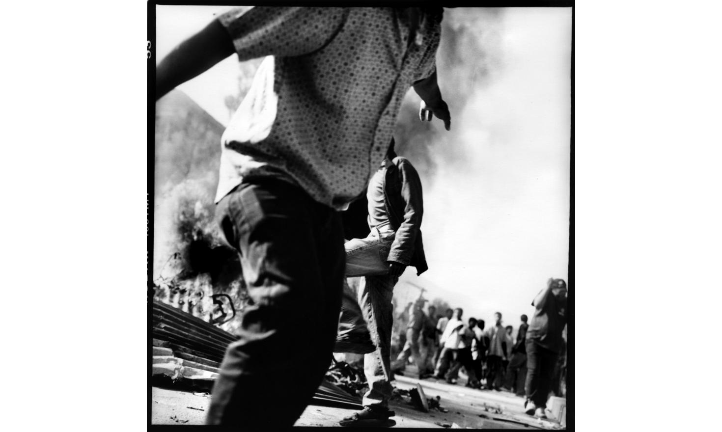 Anti Absolute monarchy protestors are burning tires, which becomes the ordinary environnement on the Ring Road during the weeks of protest. Kalanki, outskirt of Kathmandu Nepal 21st of April 2006