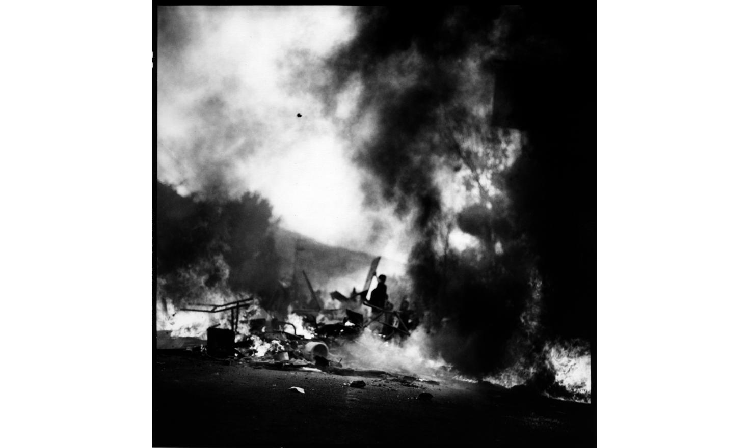 Burning tires during protests against the absolute monarchy of King Gyanendra, Kalanki outskirt of Kathmandu 21st of April 2006