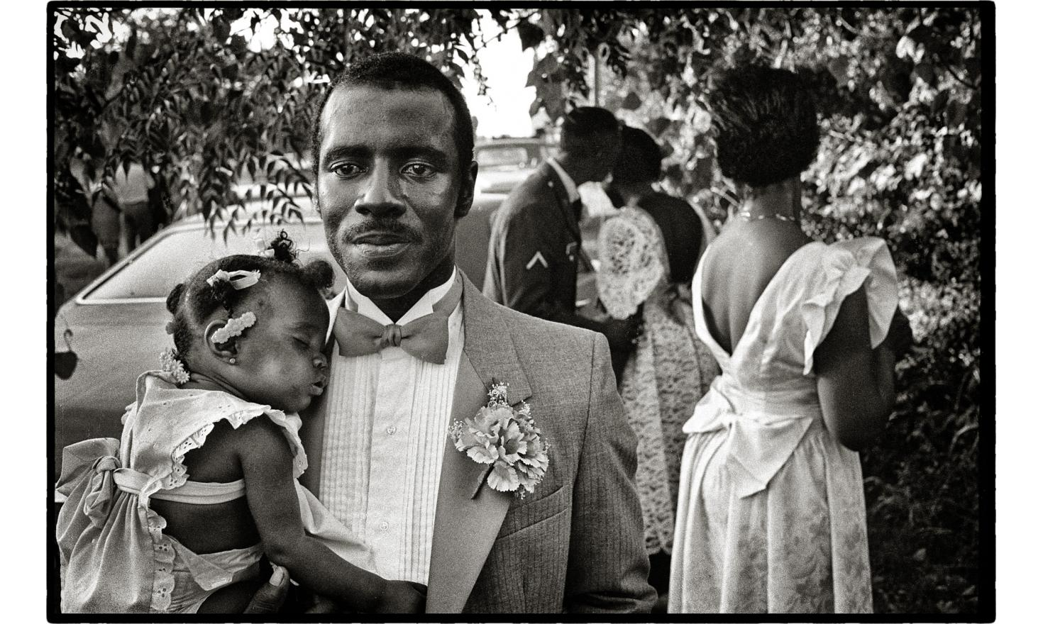 Guest and baby at a weeding. Greenville, Mississippi - 1986.