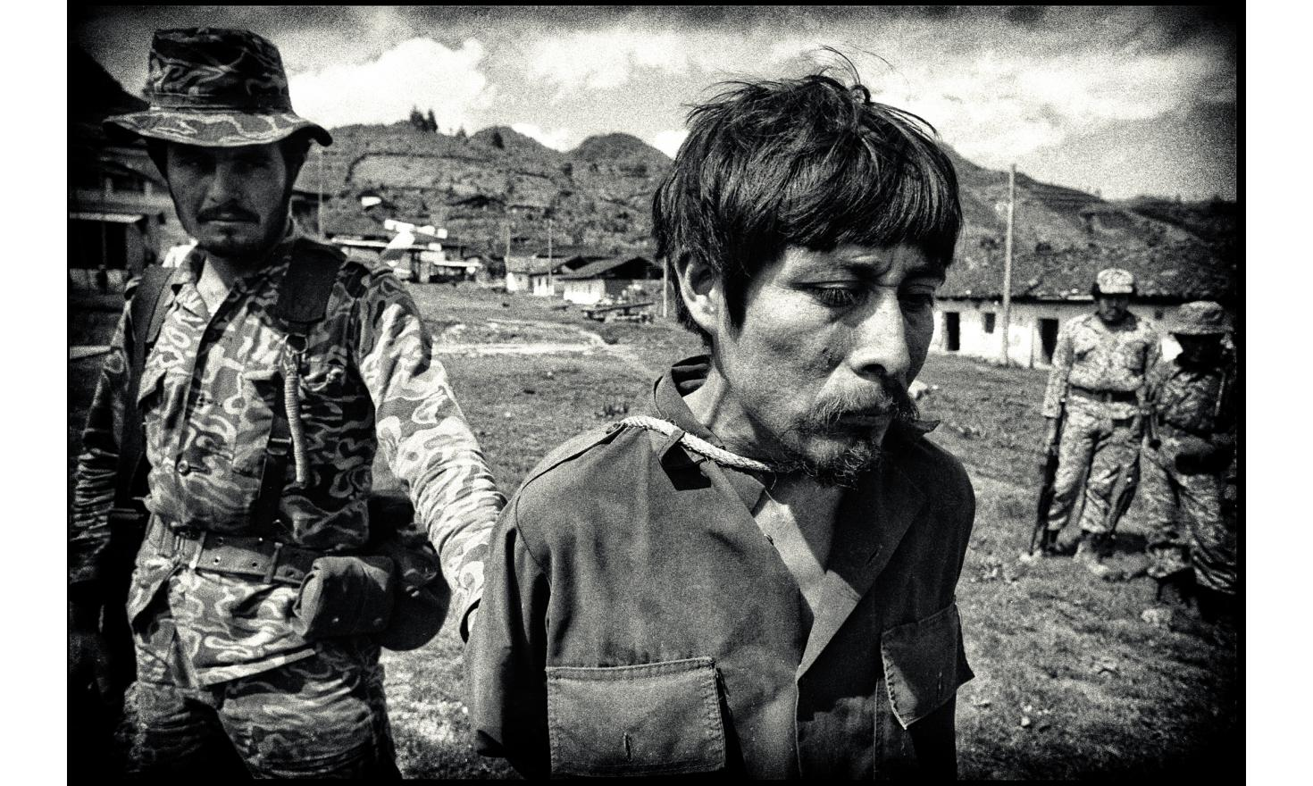 Arrested by the civil defense, a guerrilla is handled to the battalion commanded by Col. M. Benito Lucas Garcia, brother of the incubent president. A few years later , I was told by an NGO his family never heard of him. Chajul, Guatemala. March 23, 1982