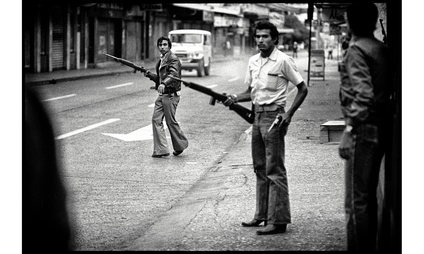Violent crackdown of a protest demonstration after the results of the presidential election. the man with a gun fired with  live ammunition at the last protestors and the journalists. Guatemala city, Guatemala. March 9, 1982