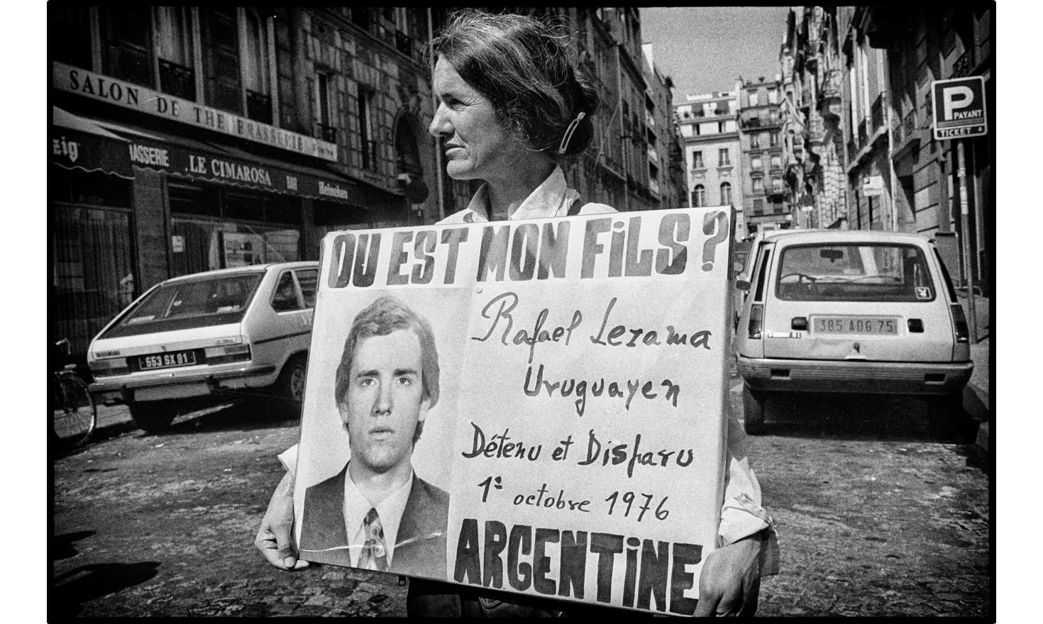 A woman is demonstrating alone. Her son has disappeared in Argentina in 1976. She has never heard of him since. Under the military, around 30.000 people have disappeared. Paris, France, august 10, 1982