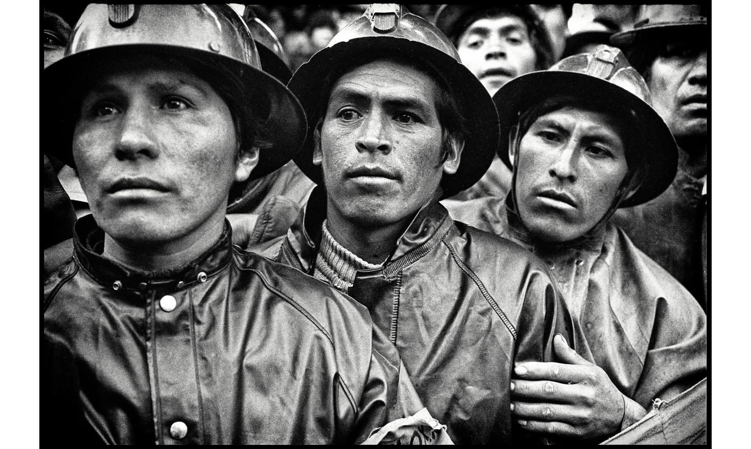 """A civilian, Hernan Siles Zuazo, is becoming president of Bolivia, after the military junta relinquished power.In the crowd, a delegation of miners coming to cheer """"their""""President. La Paz, Bolivia. October 10, 1982"""