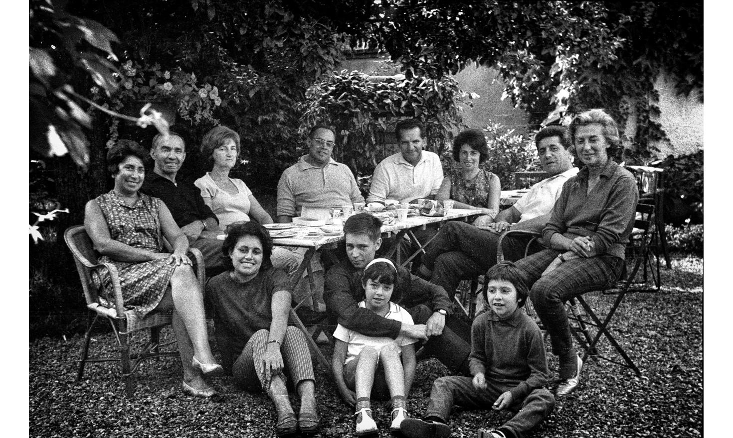 A sunday in Jouy en Josas, near Paris. Very close family, with very close friends of our parents. My mother, far left, and my father, in the center with a white polo. Jouy en Josas, 1962.