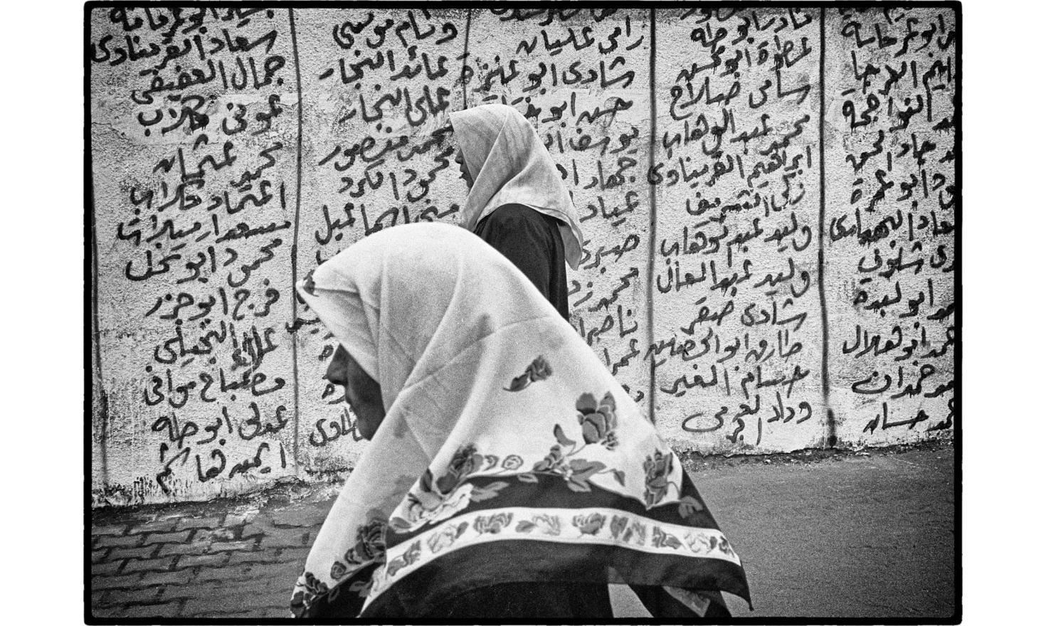"""A wall is covered with the names of the""""martyrs"""". Rafah, Occupied gaza strip. November 2004."""