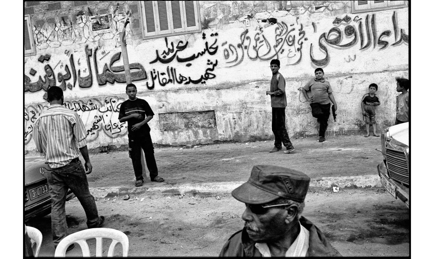 Outside the home of a bodyguard of Abu Mazen, who was killed two days ago in a shootout. Occupied gaza strip. November 2004.