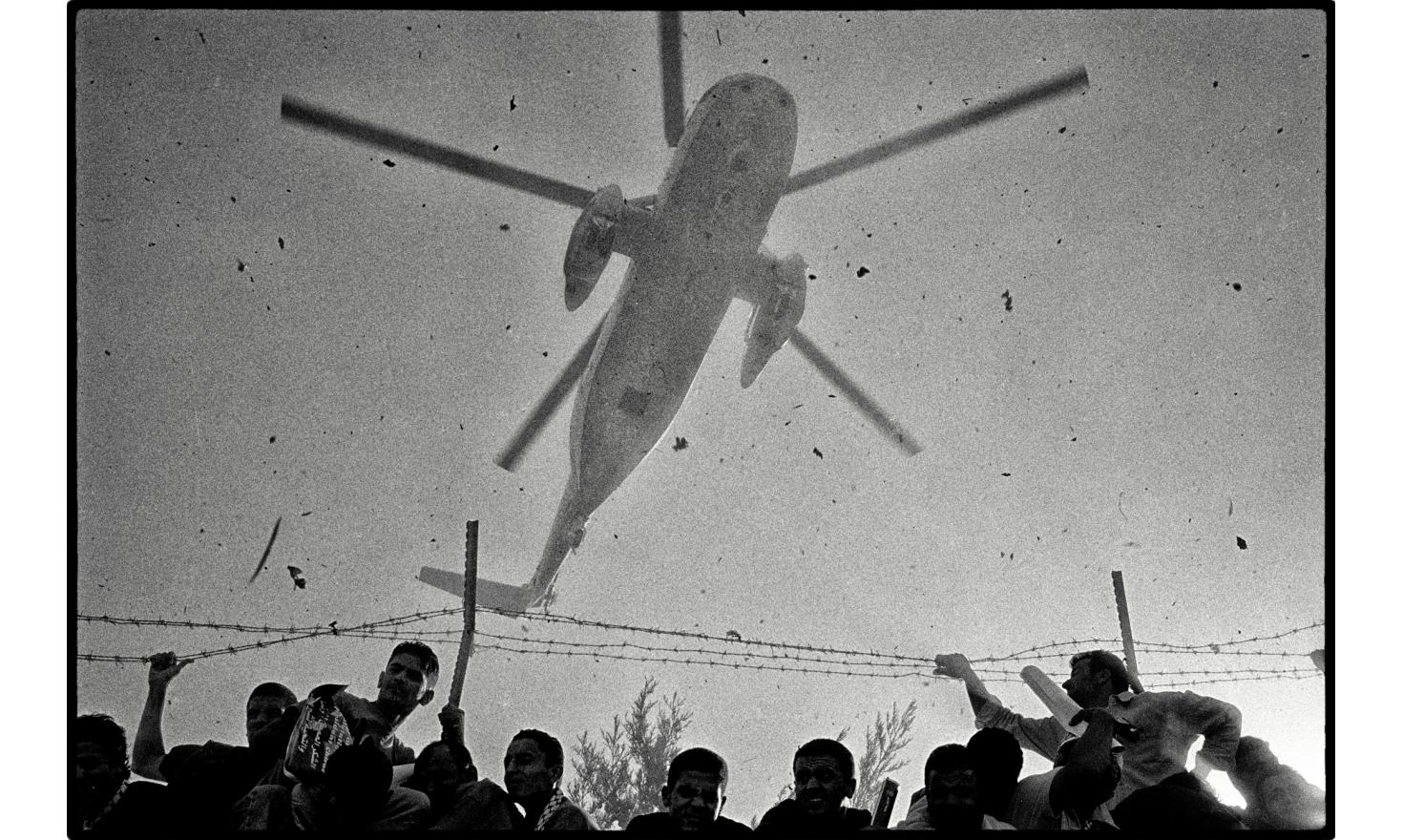 """The helicopter bringing the Arafat's coffin landed at the """"Muquata"""" headquarters. An important page in the history of the Palestinian has finished. Ramallah, Palestinian Authority. West bank. November 2004."""