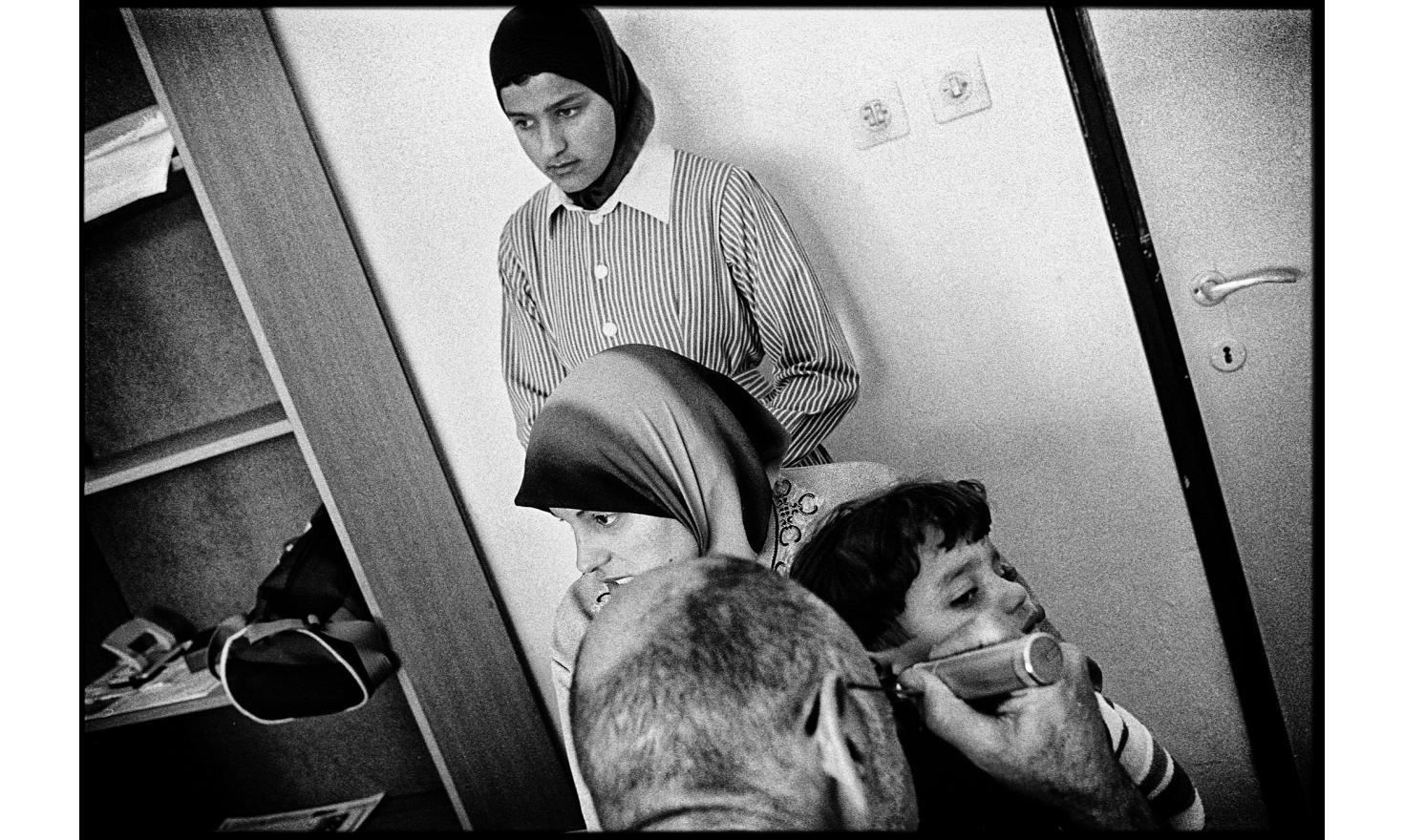 """Israeli members of the """"physicians for human rights"""" come every saturday in the occupied palestinian territories. They give free care in places without doctors or hospitals. Qalqilya, Palestinian Autority. April 2004."""