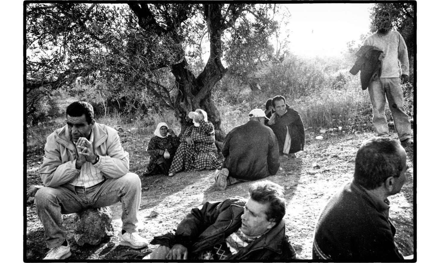 Palestinians await the opening of the security fence, near the Israeli Arab town of Um el Fahm. Israel.November 2005.