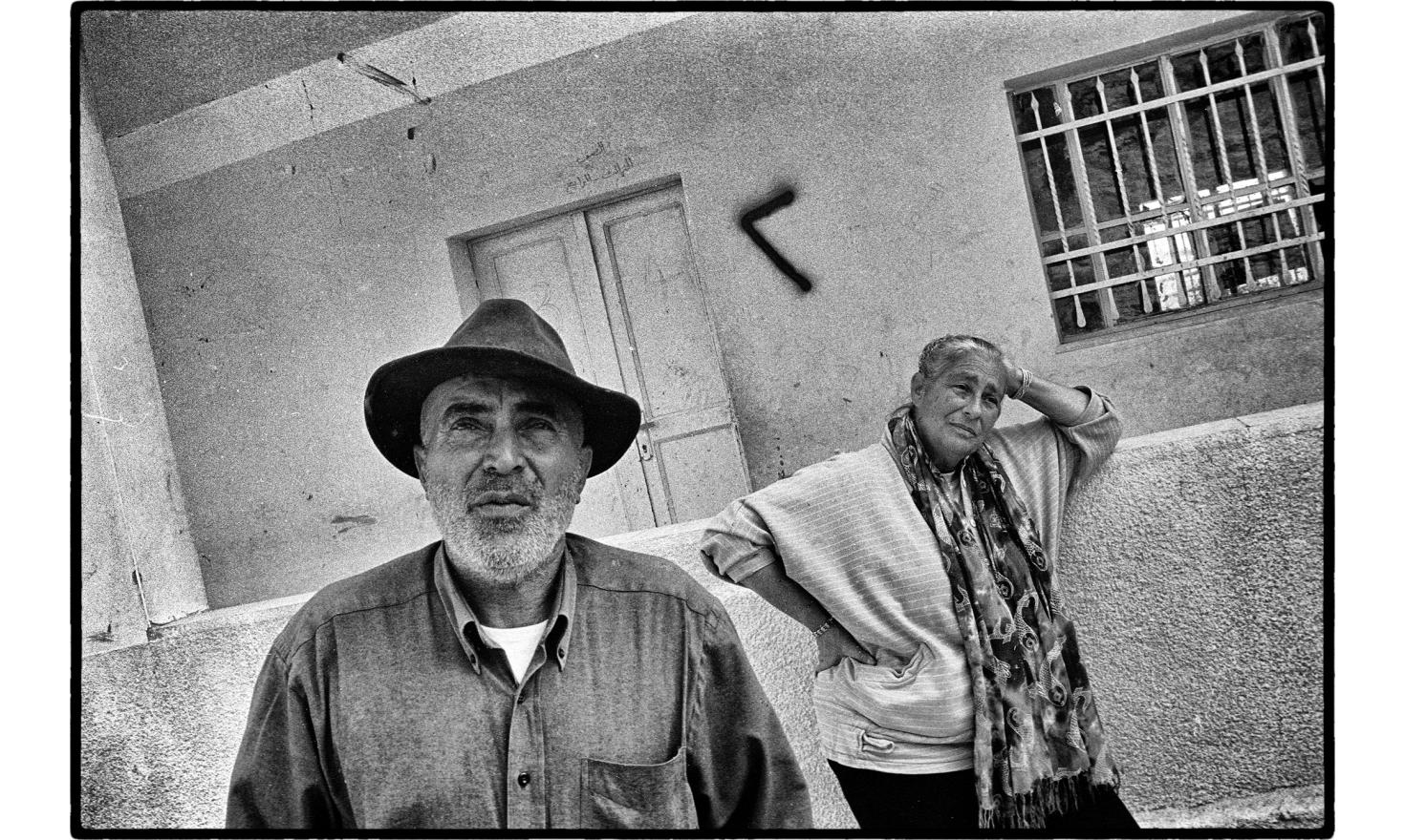 Ezra Nawi and Erella Dunayutski are Israeli citizens who spend most of their free time to help Palestinian farmers plagued by violence of some Israeli settlers. South of Hebron, West bank. November 2005.