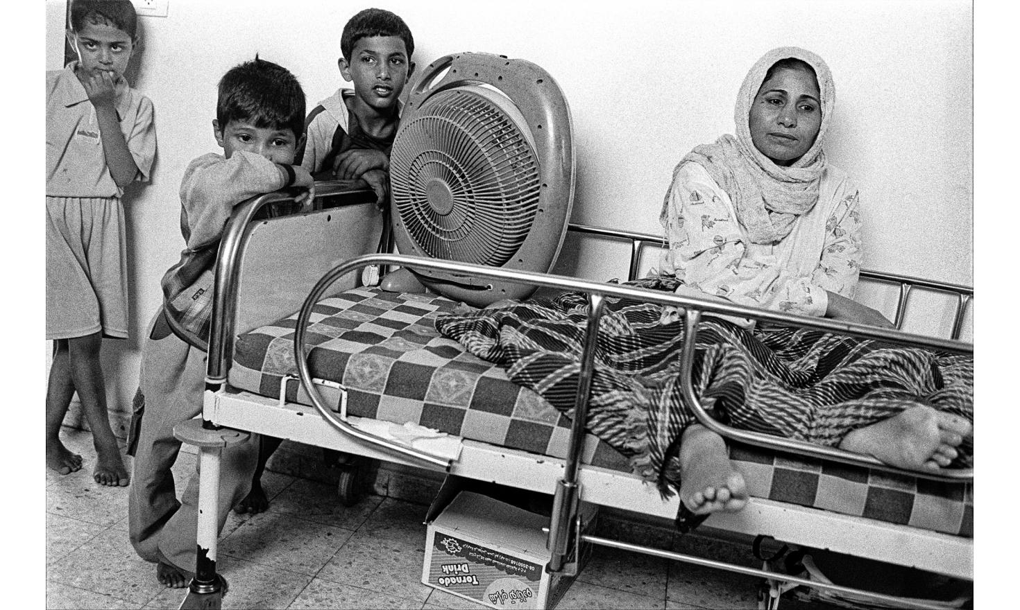 This woman has been shot accidentally by the israeli army while shopping. She doesn't know she will never be able to walk anymore. Rafah, Gaza strip. June 2006.
