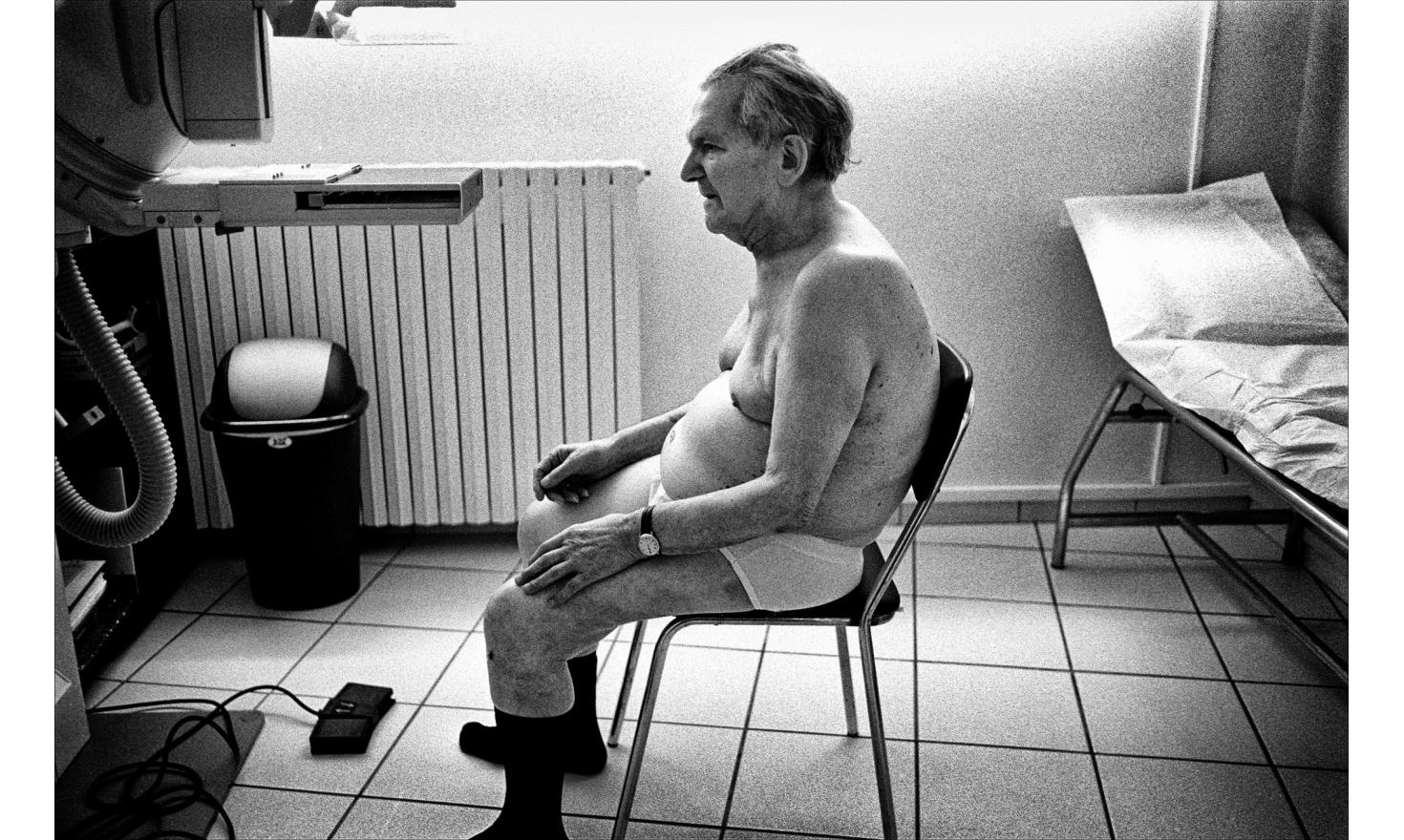 Exhausted, my father is waiting for the radiologist. I had to undress, then dress him. I hesitated a long time before taking this photo. In underwear and socks waiting seems comical.This is the last picture I took him.3 days later, he left us. 05-2003.