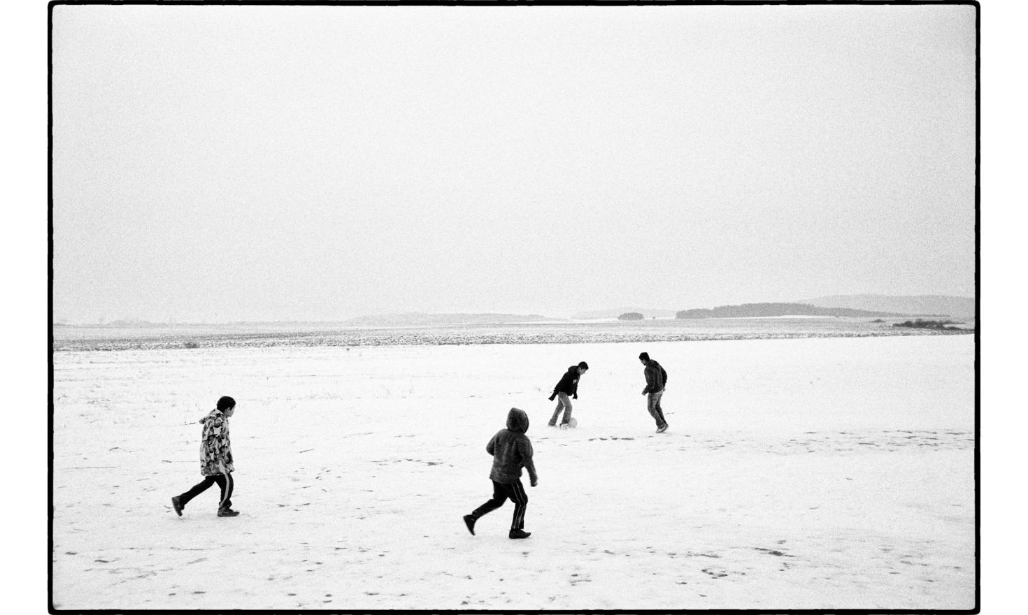 """winter is very harsh, but can be fun also, at the""""Roma osada"""", roma district of Letanovce, located at 2 kilometers from the center, at the edge of the National park of the slovak paradise. Slovakia, November 2009."""