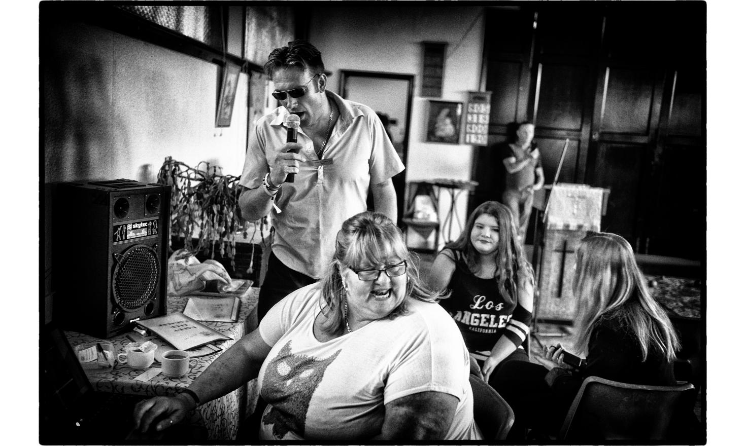 """In Jaywick, there is a man, Danny Slogett who started the""""Jaywick Happy Club"""", where people meet, sing and exchange about the town and their lives . Clacton on sea, England. July 2016."""