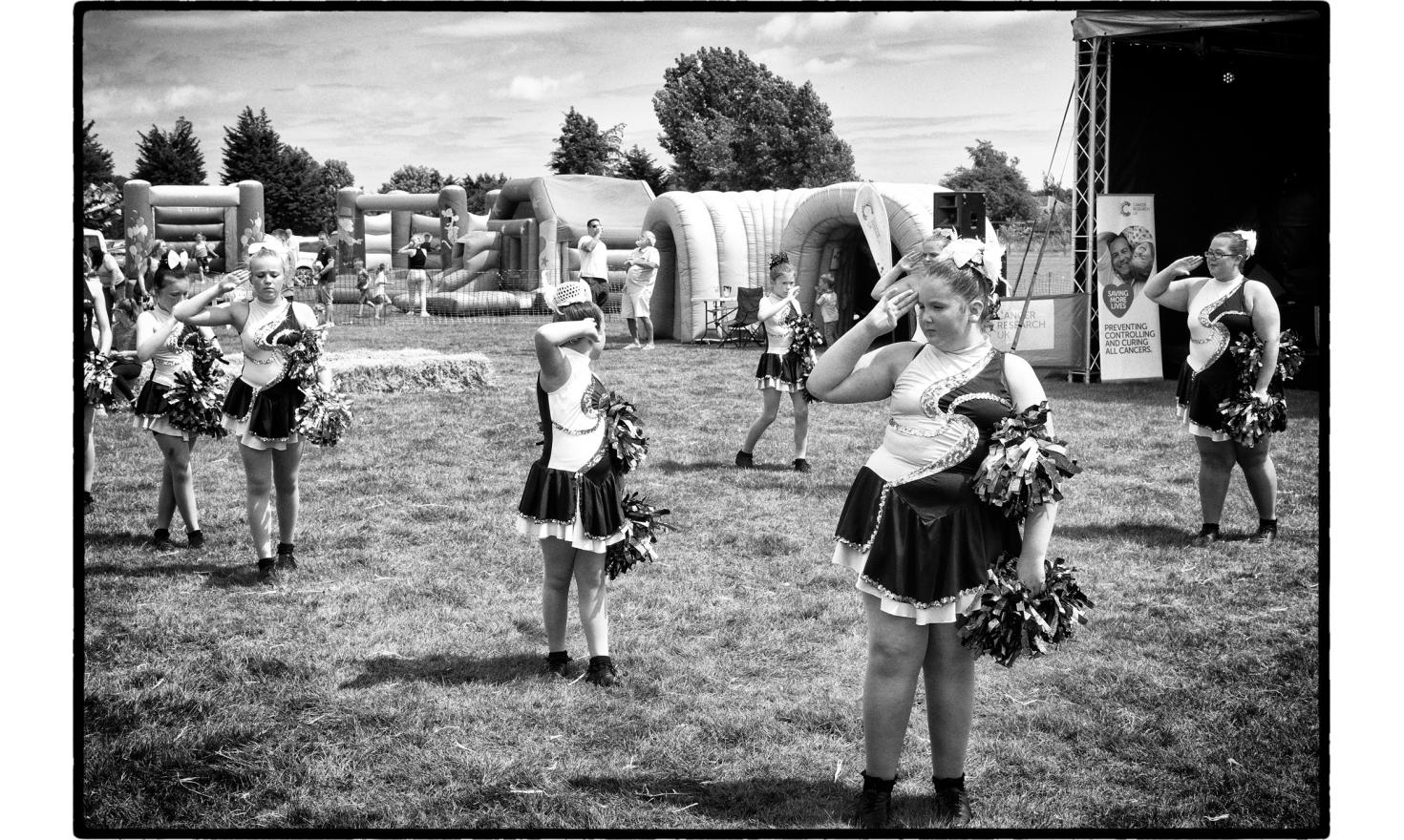 """""""Clacton relay for life"""", an event about cancer. Gathering with survivors to raise awareness and funds to fight Cancer. Music, dance with yougsters for the event. Little Clacton, England. July 2016."""