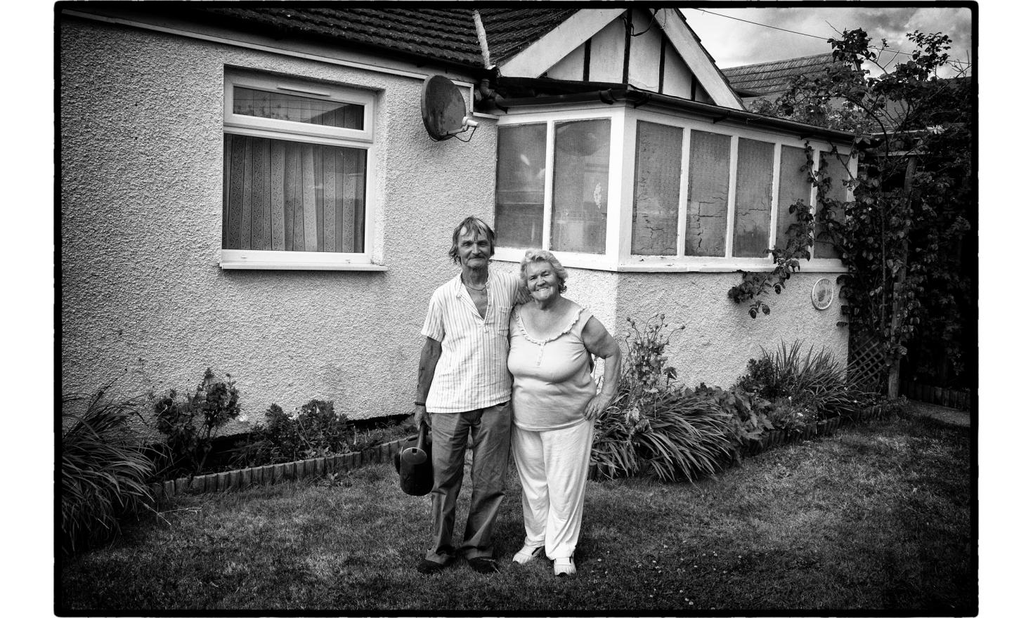 """Glenis and Roger are both 71. It has been a few years they moved to Jaywick. """"There is an amazing help here. We have never seen that elsewhere in England"""". Jaywick, England. July 2016."""