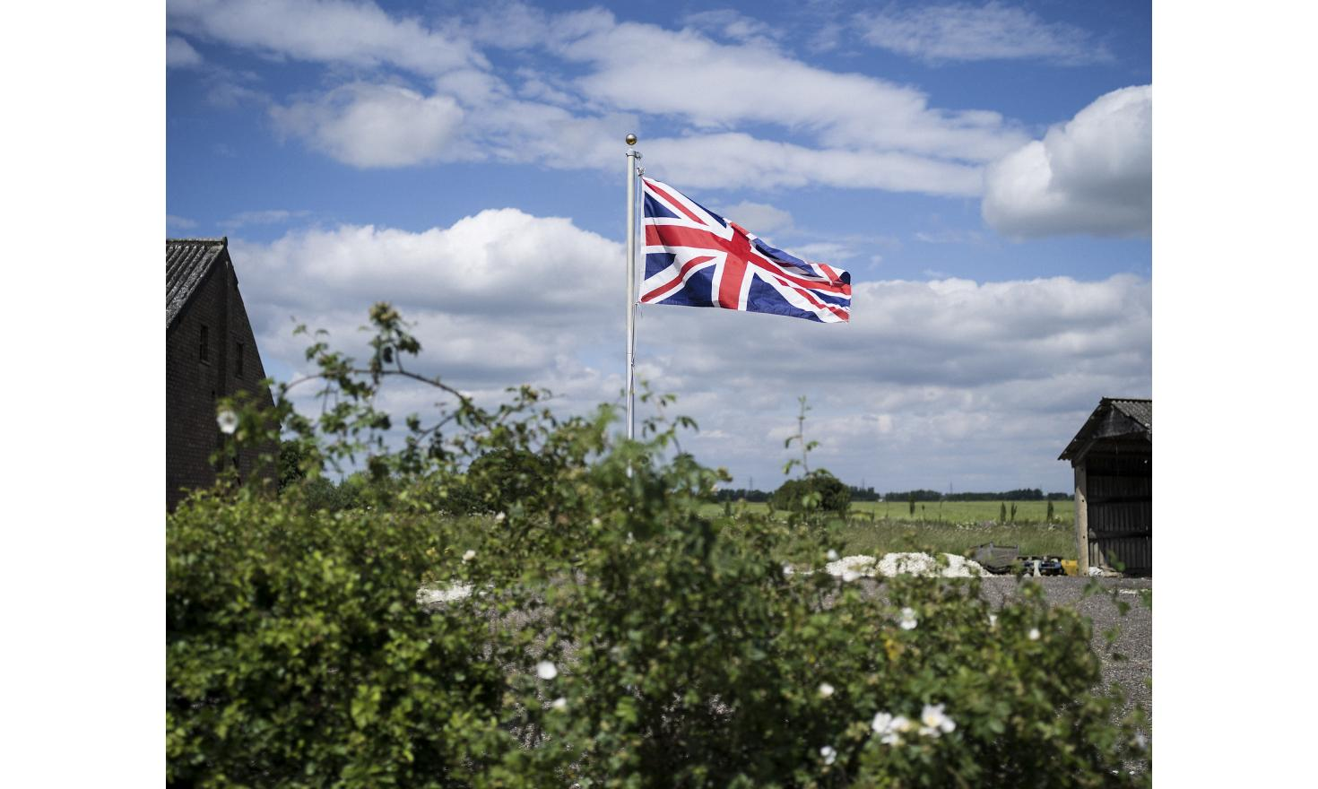 A union jack flag, flying in a field near the town of Wisbech in the agricultural flatlands of the east of England, a few miles from the town of Boston.