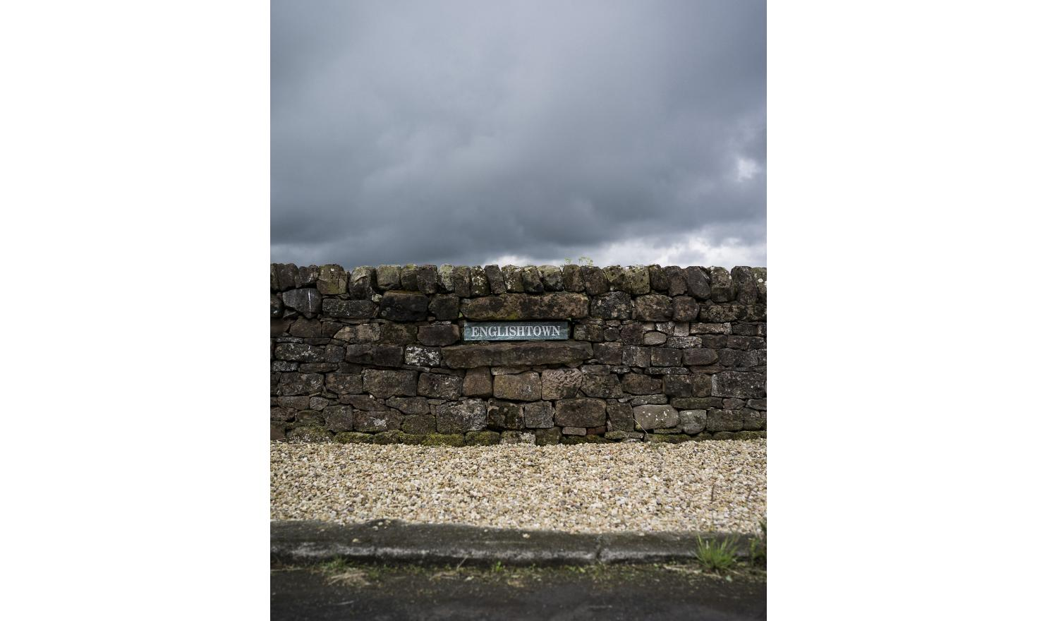 "A sign in a wall on the border between Scotland and England reads ""Englishtown"". The two countries were divided by the Brexit vote, with Scotland choosing to remain and England choosing to leave"
