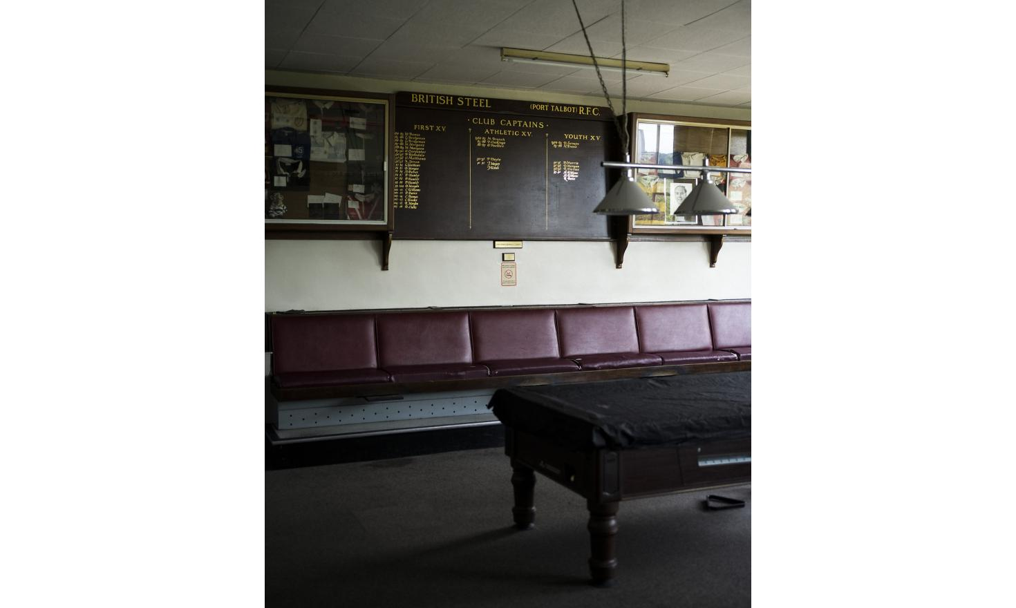Inside the Tata Steel Social Club, in Port Talbot, South Wales. The steelworks originally belonged to British Steel and the name is still visible on the board behind the snooker tables.