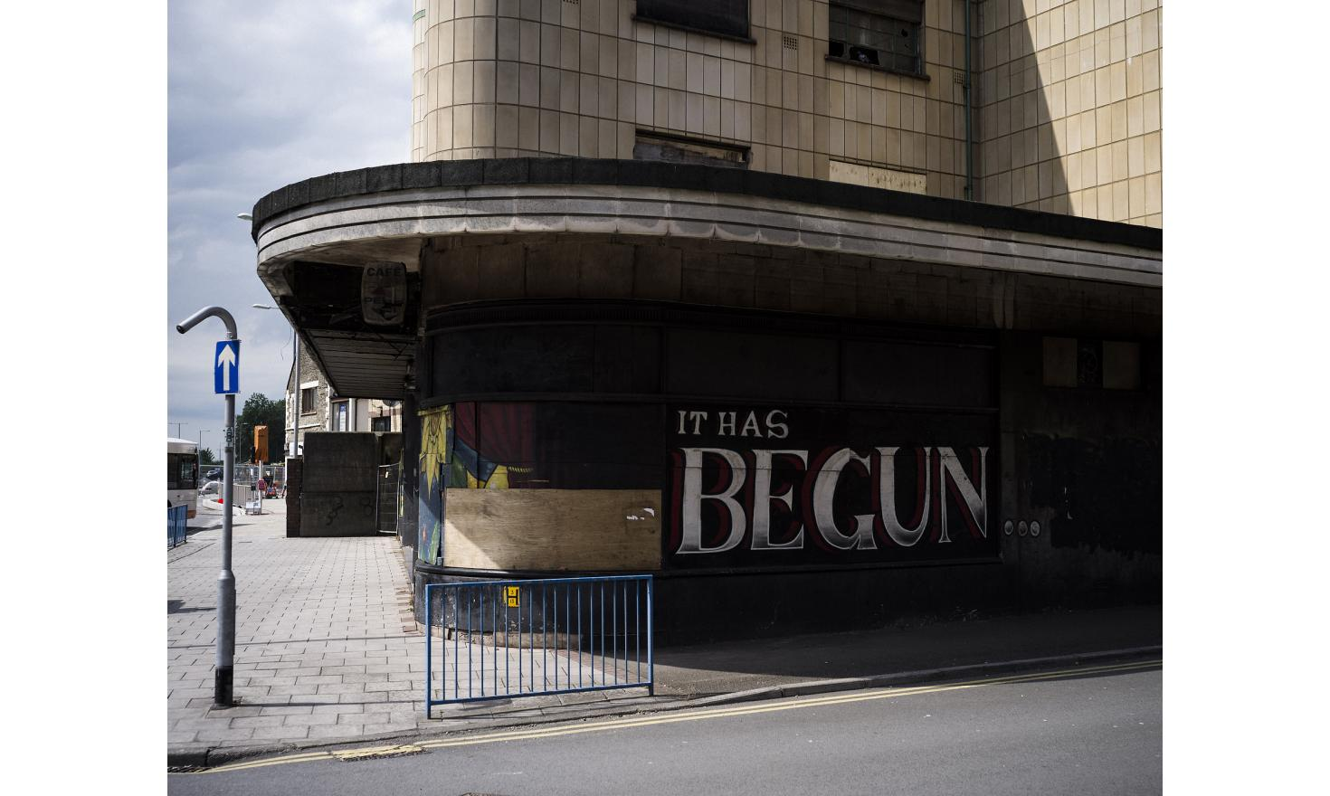 "Graffitti on the side of a closed-down cinema in Port Talbot, South Wales reads, ""IT HAS BEGUN..."". The once-affluent town is in decline."