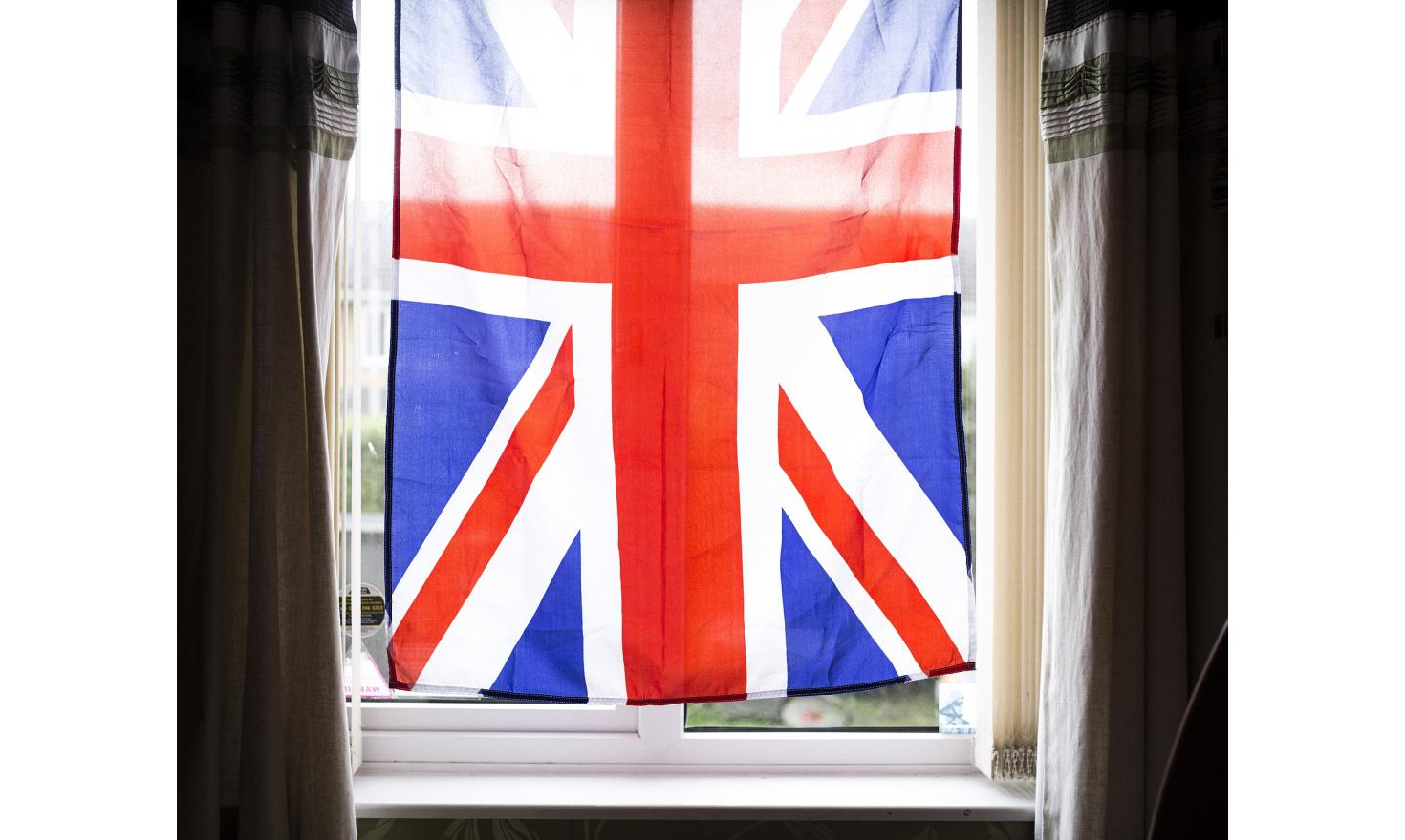 A Union Jack flag hangs in the window of Ashley Greenup's office at his home in Carlisle in the north-west of England.