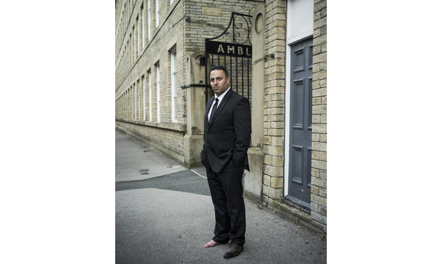 """Mohammed Naz is a security guard in Bradford. He is the grand-son of immigrants from Kashmir. The offices are housed in a former textile mill, where his father used to work. He believes the town voted to leave because the are """"many fascists here""""."""