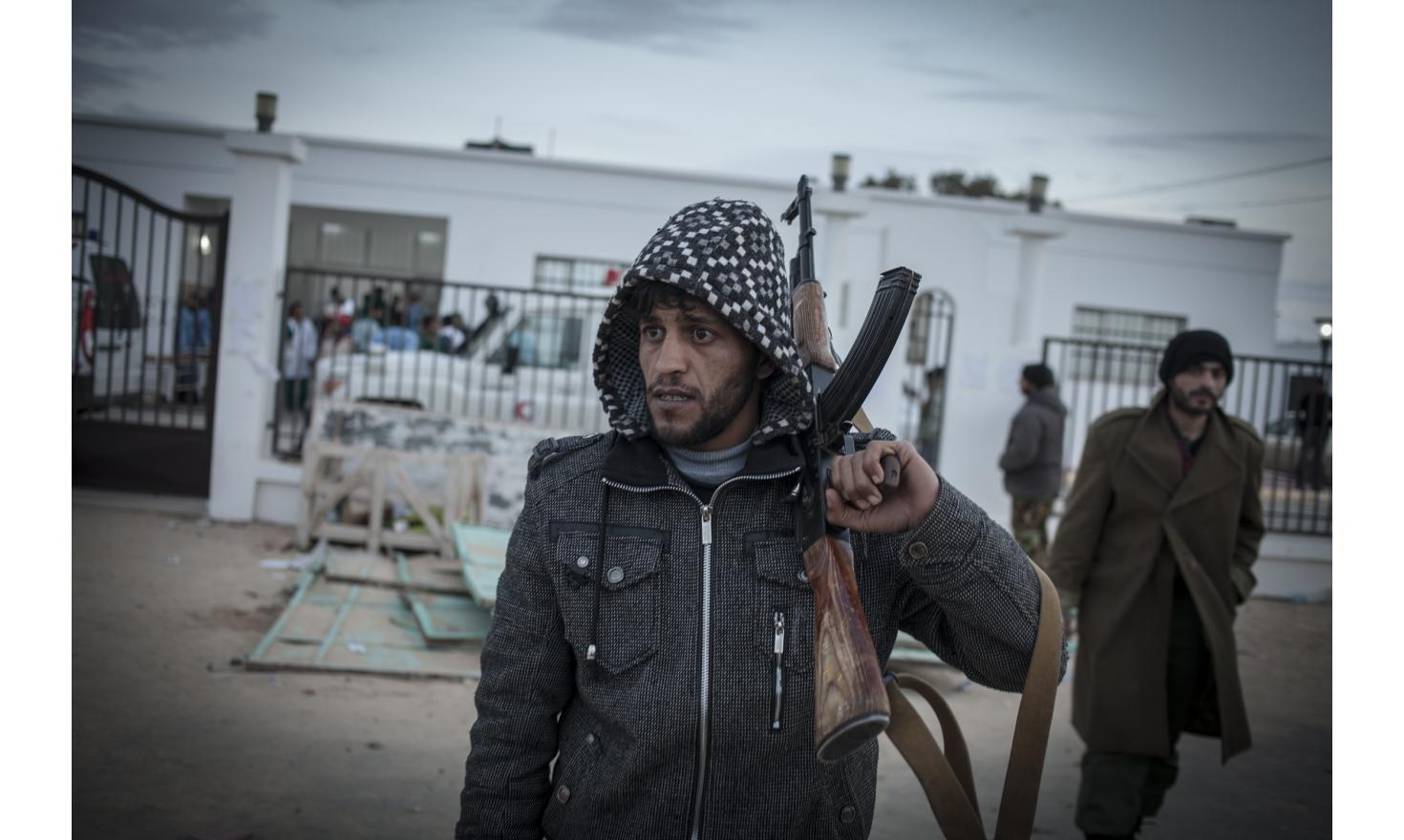On the road to Syrte /  Eastern Libya / - Benghazi, Ajdabiya, Brega, Ras Lanuf, ...Rebels in Libya have been celebrating after fighting off an attempt by troops loyal to Col Muammar Gaddafi to retake the eastern oil port of Brega. Insurgent in Ras Lanouf.