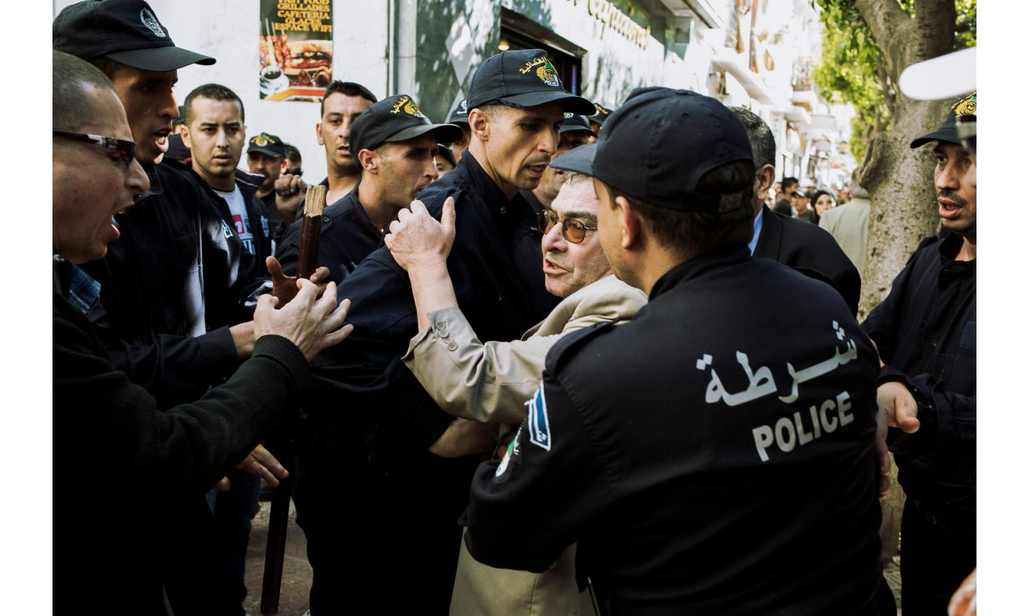 "In Algiers, Police stops an attempt of demonstration of the opposition movement ""Barakat"" (means ""that's enough !"")"