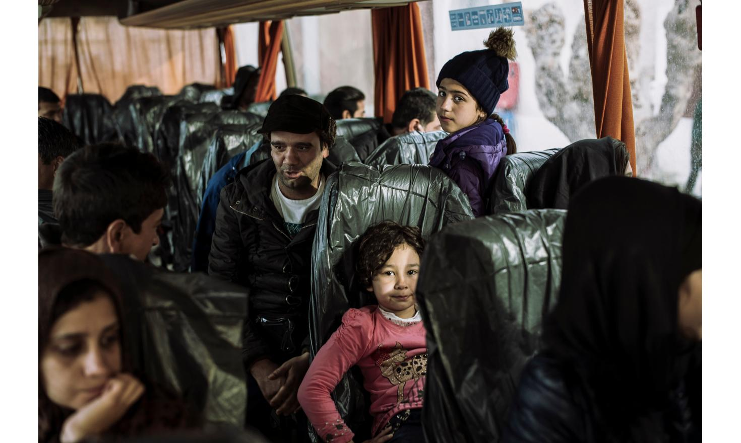 MSF bus with refugees going to take a ferry to Athens