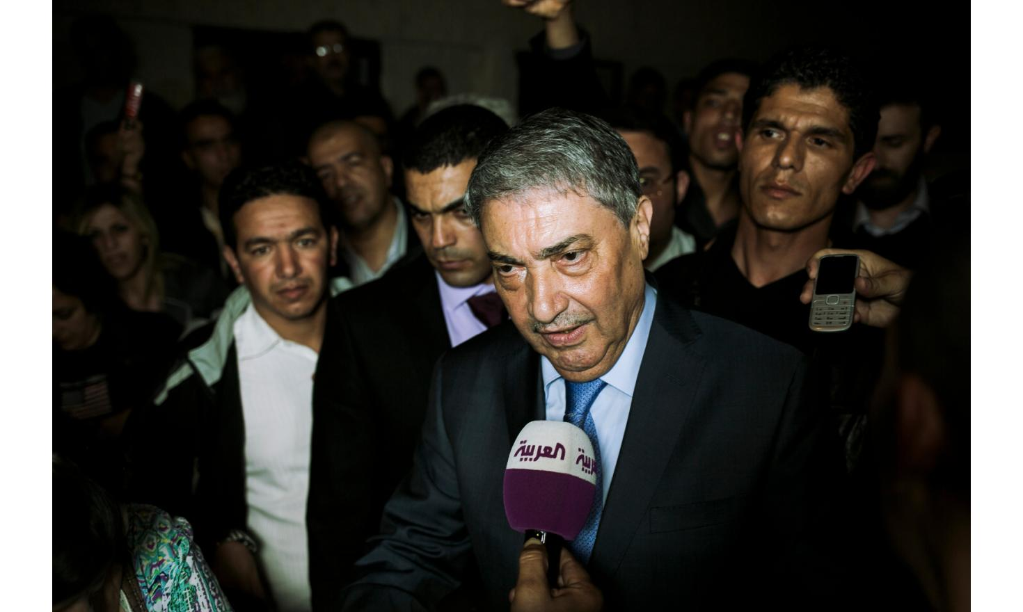 Ali Benflis speaking with journalists after his defeat