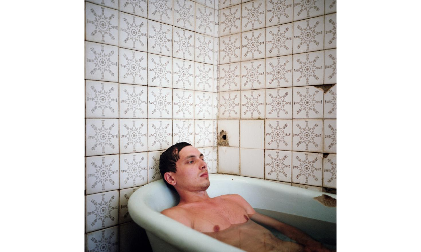 A Russian tourist takes a bath with sulfurous water in a sanitarium in Gagra.