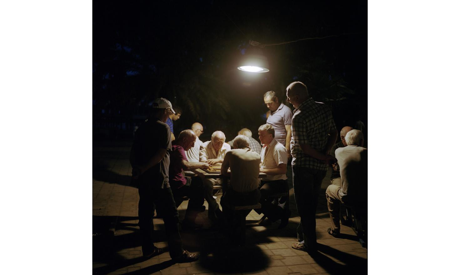 Evening in Sukhum(i). Men meet and play draughts, chess and backgammon in this little square.