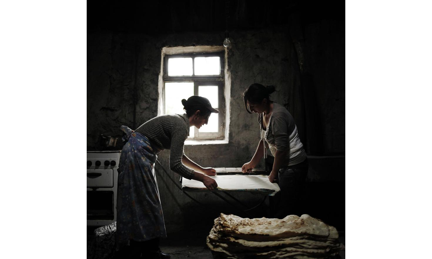 Anoush and Ruzanna, prepare lavash, the traditional Armenian bread. Women prepare it in large quantities and then keep it for one or two weeks. It's a way of saving money. Their husbands are brothers and both work in Russia.