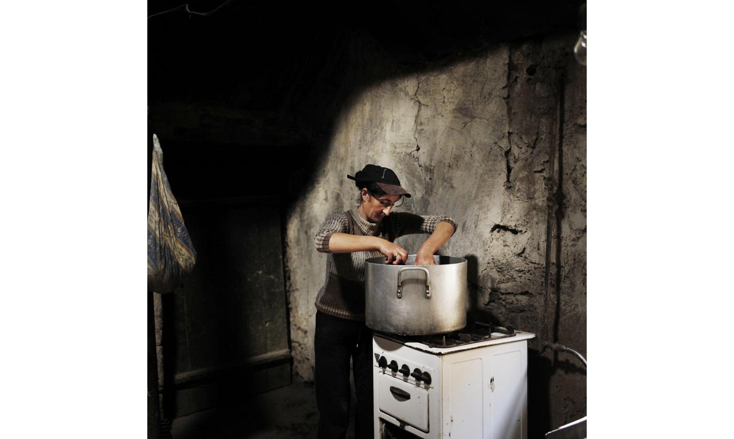 Anoush cook canned peppers. The cans are stored for the winter. The village's families are almost self-subsistent: fruits and vegetables from the garden, milk, butter and cheese from the cows, homemade lavash. However the work to obtain this is huge.