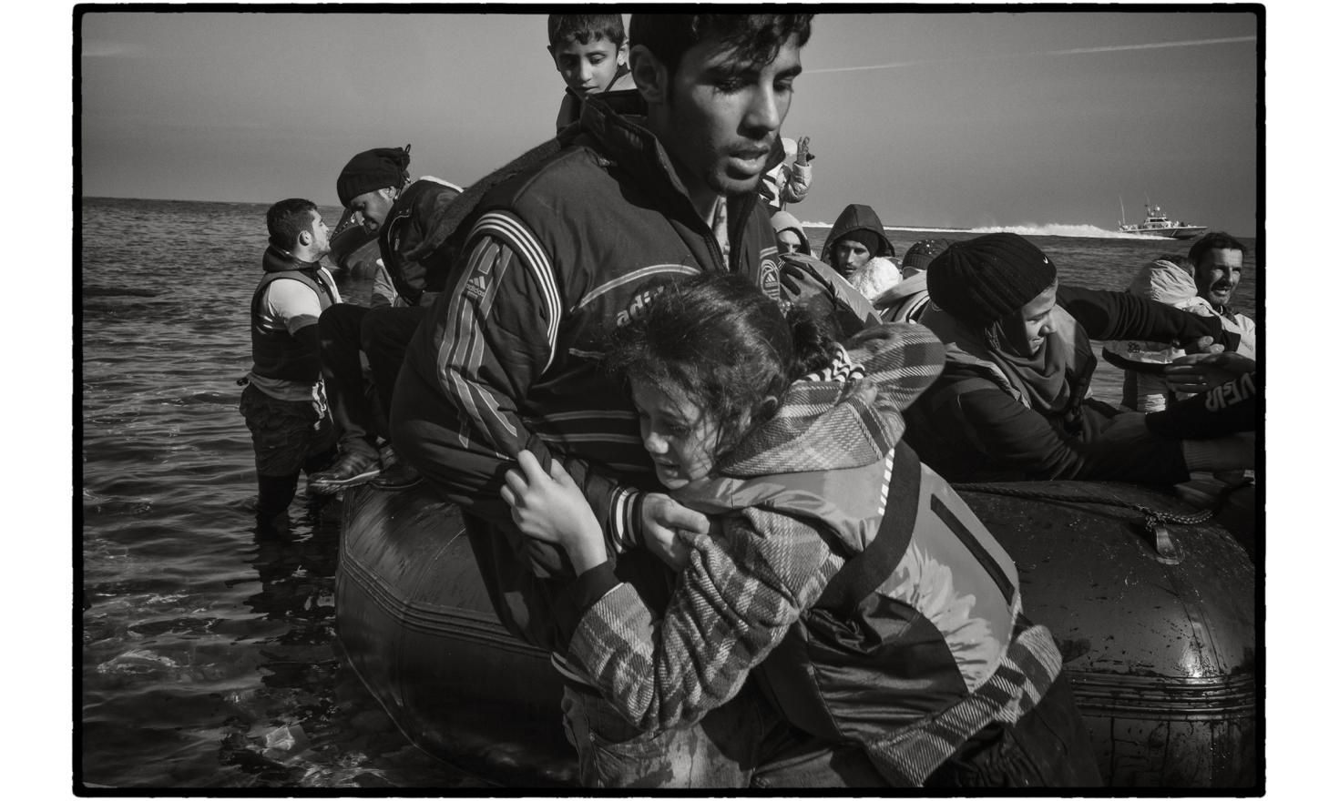 Lesbos, Greece. More often than not refugees cross in these inflatable zodiac boats, with traffickers managing to cram in over 50 people on each boat.