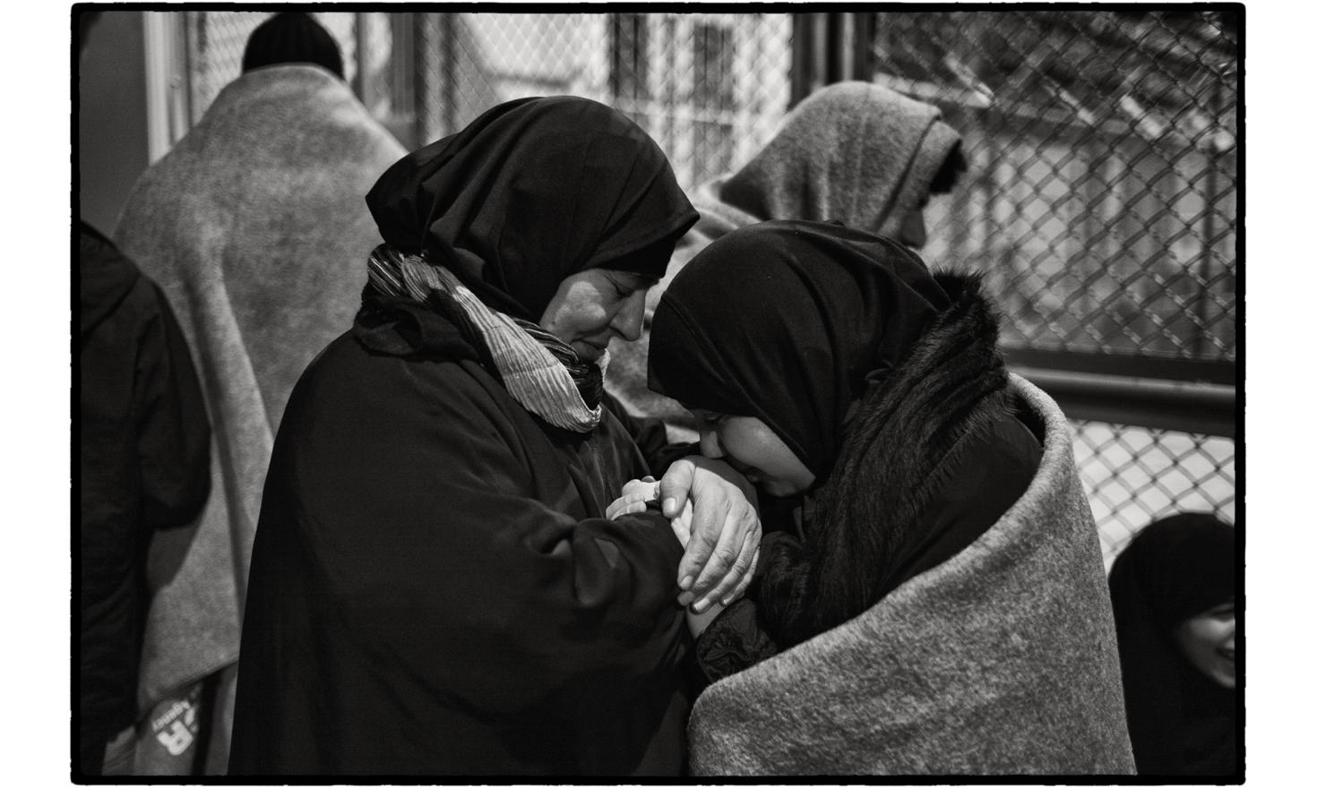 Moria 'Hotspot', Lesbos, Greece. The wait for the registration procedure is a long one. Families have to queue for hours.