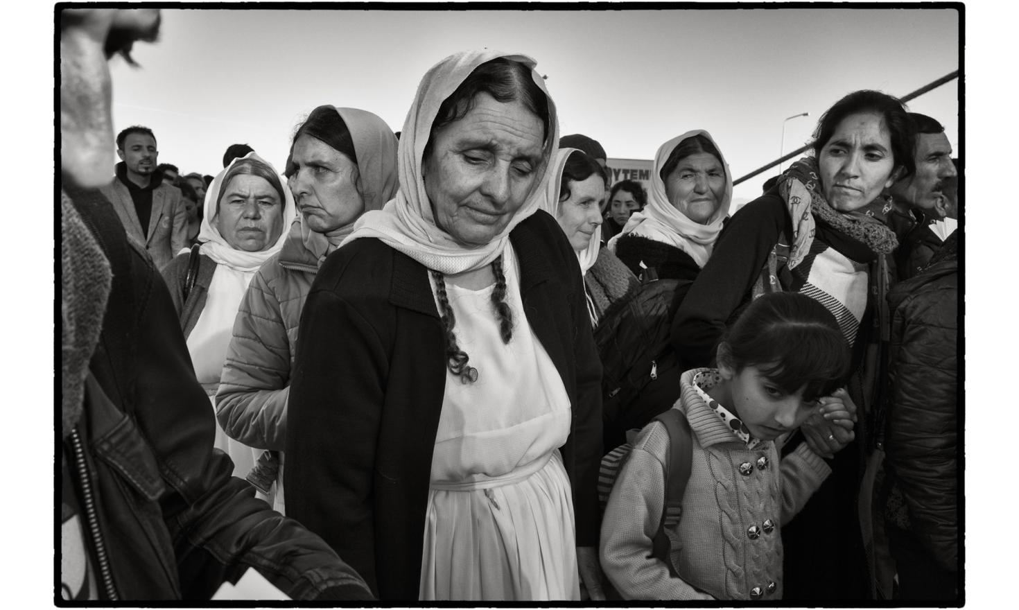 Mytilini's harbour, Lesbos, Greece. Refugees, after being registered at Moria camp, wait to board the ferry to Athens.