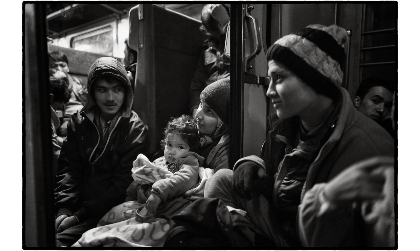 Gevgelija, Former Yugoslav Republic of Macedonia. At the Gevgelija transit camp, train convoys arranged by state authorities await the refugees. Families eager to continue their journey to northern Europe pile onto the trains. Men, women, children, old pe