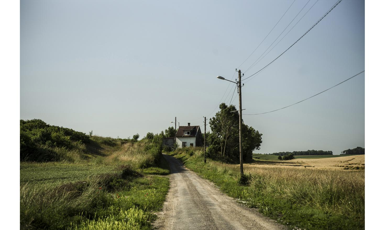Berteaucourt-les-Danes , which is about 30kms far from Amiens. 1160 peoples live in the village. Here isa way to an isolated house.