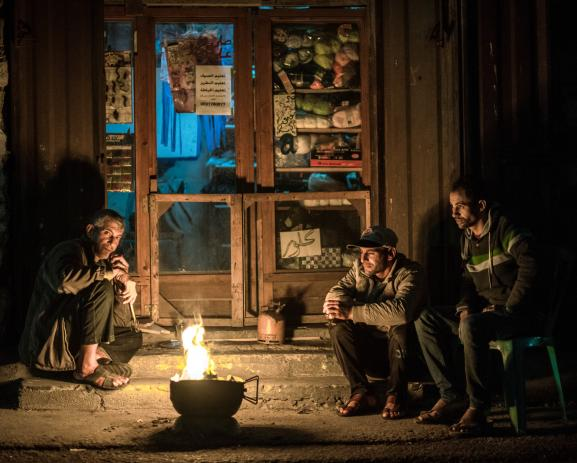 Inhabitants from Gaza City light up a fire to light themselves but also to burn waste and warm themselves up.